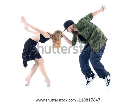 Gymnast and rapper stand on tiptoe, arms tossed back isolated on white background. Man keeps head of woman. - stock photo