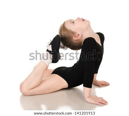 Gymnast cute little girl doing exercises isolated on white - stock photo