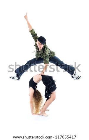 Gymnast does bridge and smiling rapper jump above her isolated on white background. - stock photo