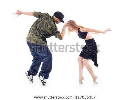 Gymnast in black dress and rapper stand on tiptoe, arms tossed back isolated on white background. Man keeps head of woman. - stock photo