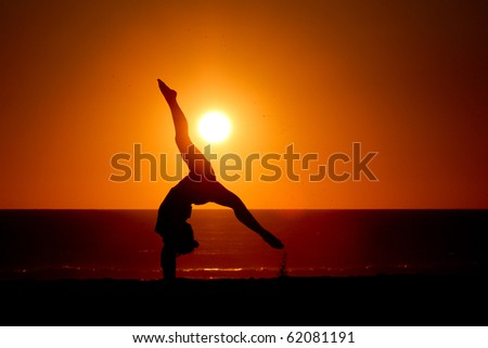 gymnast in sunset - stock photo