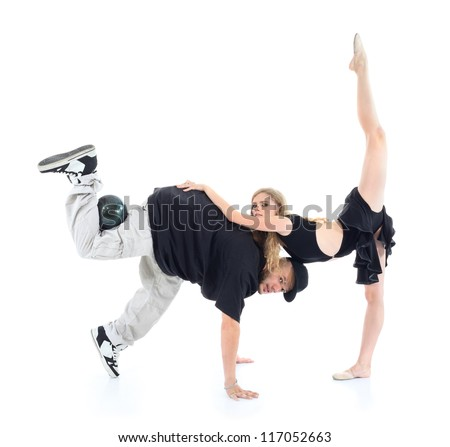 Gymnast stands on one leg, other leg lifted up and rests hands on man and rapper stands on one leg and arms and other leg holds ball isolated on white background. - stock photo