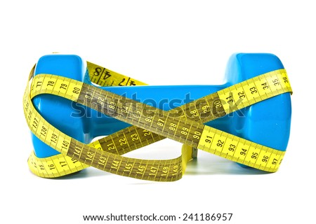 Gymnastics dumbbell and tape measure on a white background - stock photo