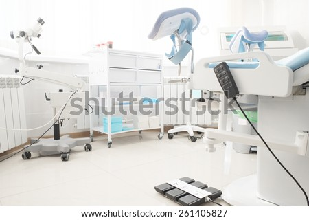 Gynecological chair in gynecological room - stock photo