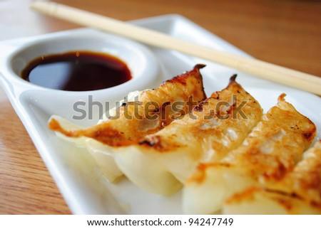 gyoza on white plate - stock photo