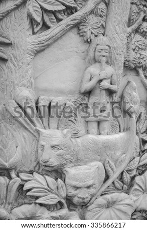 Gypsum bas in traditional style on wall of fence, Thailan - stock photo