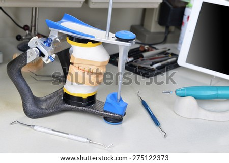 gypsum model of jaw and basic dentist tools - stock photo