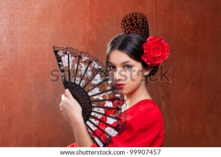 Gypsy flamenco dancer Spain girl with red rose spanish hand fan and peineta comb - stock photo