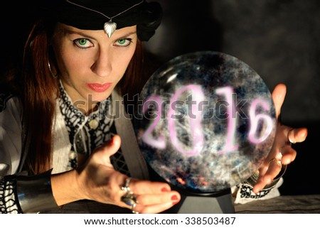 gypsy fortune teller forecasting 2016 new year it's coming - stock photo
