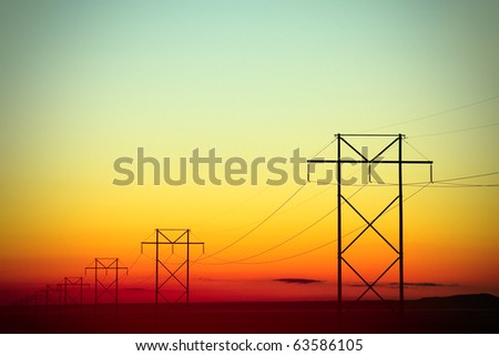 H-Frame Electrical Poles Silhouette at Daybreak - stock photo