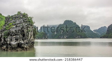 Ha Long Bay in Vietnam in rainy weather - stock photo