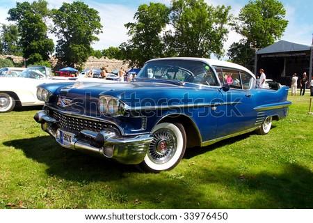 HAAPSALU, ESTONIA - JULY 18: American Beauty Car Show, showing blue 1958 Cadillac Coupe De Ville, front view on July 18, 2009 in Haapsalu, Estonia - stock photo