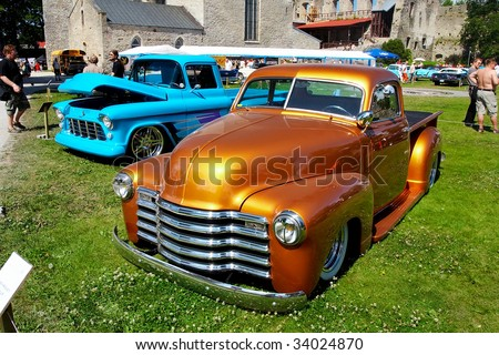 HAAPSALU, ESTONIA - JULY 18: American Beauty Car Show, showing orange 1948 Chevrolet Pickup, front view on July 18, 2009 in Haapsalu, Estonia - stock photo