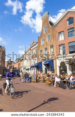 HAARLEM, THE NETHERLANDS - SEPTEMBER 1: Typical bars with medieval architecture on September 1, 2012, Haarlem, Netherlands. The bars are located in the Market Square square and full during the summer. - stock photo