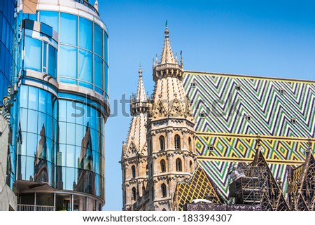Haas Haus with St. Stephen's Cathedral at Stephansplatz in Vienna, Austria - stock photo