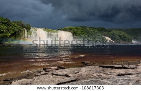 Hacha waterfall in the lagoon of Canaima national park before the storm - Venezuela, South America - stock photo