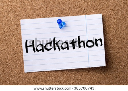 Hackathon - teared note paper pinned on bulletin board - horizontal image - stock photo