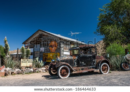 HACKBERRY - 2008 AUGUST 18: Hackberry General Store with a old car car in front on August 18, 2008 in Hackberry , Arizona, USA. Hackberry General Store is a popular museum of old Route 66. - stock photo