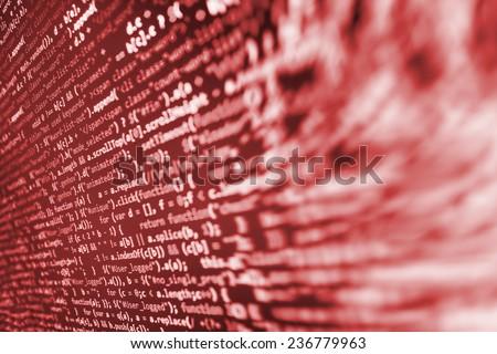 Hacker, bad software or online theft metaphore. Computer red screen- danger, virus threat. Program application script code fragment. Shadow and vignette spotlight effect. - stock photo