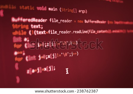 Hacker, bad software or online theft metaphore. Computer red screen- danger, virus threat. Program application script code fragment. Shadow and vignette spotlight effect. Red color. - stock photo