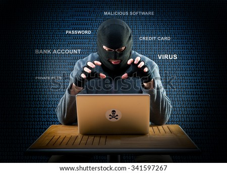 Hacker is ready to start hacking laptop - stock photo