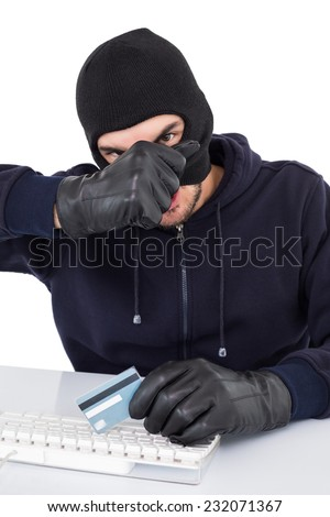 Hacker removing his balaclava to show his face on white background - stock photo