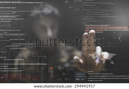 hacker silhouette with graphic user interface around - stock photo