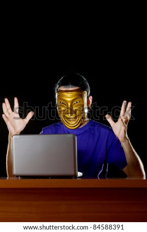 Hacker sitting in dark room - stock photo