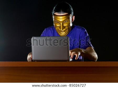 Hacker sitting in dark room - stock photo