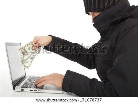 Hacker Steal money from the Internet with laptop  - stock photo