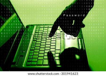 Hacker using laptop - stock photo
