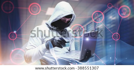 Hacker using laptop to steal identity against abstract glowing black background - stock photo