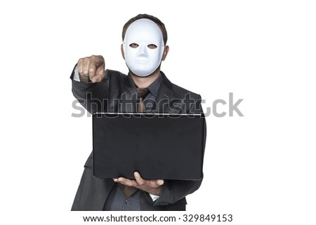 hacker wering a mask - stock photo