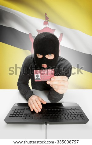 Hacker with ID card in hand and flag on background - Brunei - stock photo