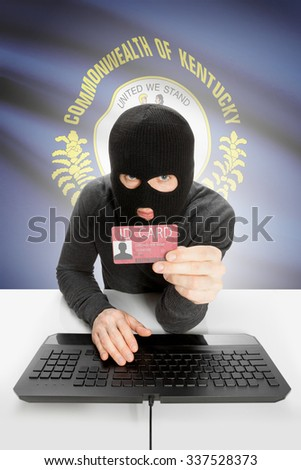 Hacker with ID card in hand and USA states flag on background - Kentucky - stock photo