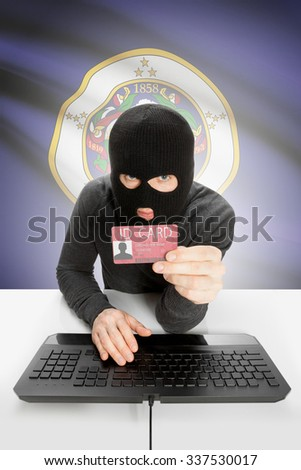 Hacker with ID card in hand and USA states flag on background - Minnesota - stock photo