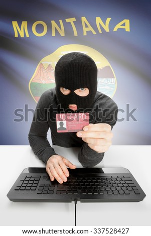 Hacker with ID card in hand and USA states flag on background - Montana - stock photo