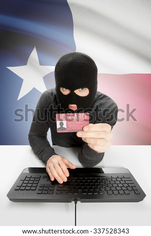 Hacker with ID card in hand and USA states flag on background - Texas - stock photo