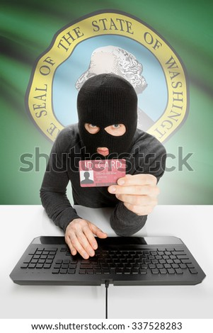 Hacker with ID card in hand and USA states flag on background - Washington - stock photo