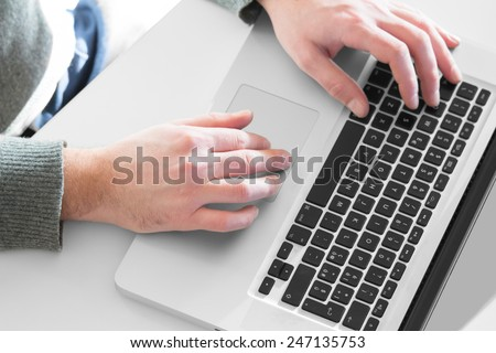Hacker working on a laptop. - stock photo