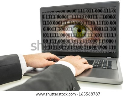 Hacker working on laptop with human eye with digital binary code on screen. Concept of internet surveillance and espionage. - stock photo