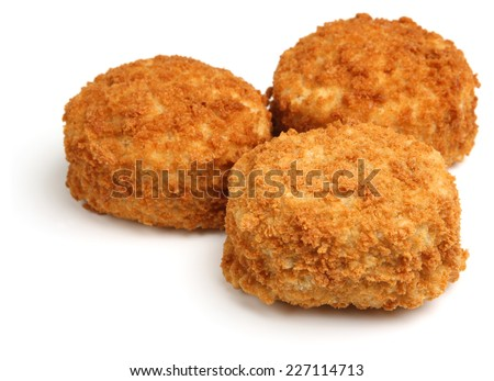 Haddock fishcakes on white background - stock photo