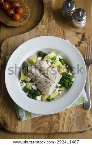 Haddock with new potatoes and steamed vegetables - stock photo