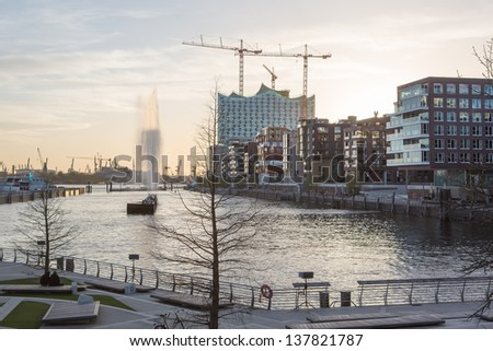 Hafencity district with Elbphilharmonie in Hamburg in evening light - stock photo