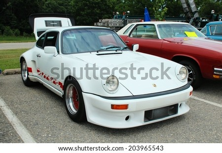 HAGERSTOWN, MD - JUNE 29, 2014: Image of a Porsche, proceeds from the car show benefit the newspapers in education program.  - stock photo
