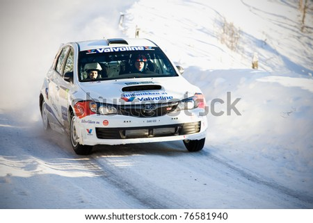 HAGFORS, SWEDEN - FEB 10: Anders Grondal drivning his Subaru during the World Rally Championship event Rally Sweden in Hagfors, Sweden on Feb 10, 2011 - stock photo
