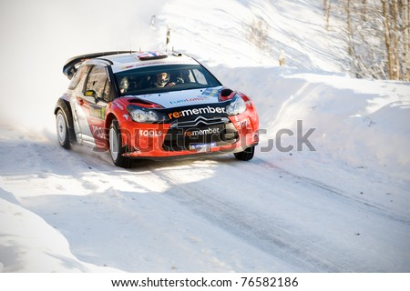 HAGFORS, SWEDEN - FEB 10: Petter Solberg drivning his Citroen DS3 WRC during the World Rally Championship event Rally Sweden in Hagfors, Sweden on Feb 10, 2011 - stock photo