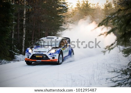 HAGFORS, SWEDEN - FEB 09: SOLOWOW Michal in his Ford Fiesta WRC during the Shakedown stage in  Rally Sweden 2012 in Hagfors , Sweden on Feb 9, 2012 - stock photo