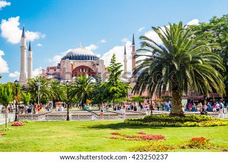 Hagia Sophia (Ayasofya) museum and huge palm tree view from the Sultan Ahmet Park in Istanbul, Turkey - stock photo