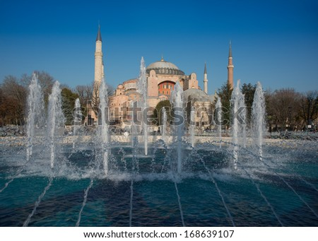 Hagia Sophia (Turkish: Aya Sofya) is a former Orthodox patriarchal basilica, later a mosque, and now a museum in Istanbul, Turkey. Fountains and blue pool are in the foreground. - stock photo